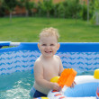 Curly haired girl in backyard pool — Stock Photo