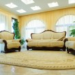 Leather sofa and armchairs — Stock Photo