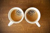 Dwa kubki whte przy espresso — Zdjęcie stockowe