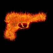 Brinnande pistol siluett eld på svart bakgrund — Stockfoto