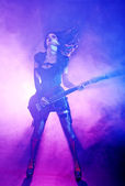 Sexy woman plays guitar at the concert — Stock Photo