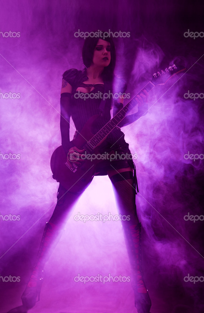 Sexy woman playing guitar at the concert — Stock Photo #11522199