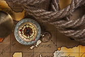 Compass and rope on map — Stock Photo