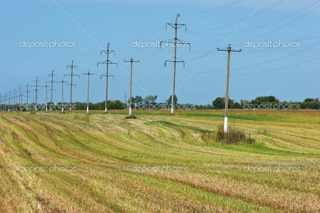 High voltage power pole on the field — Stock Photo #12050443