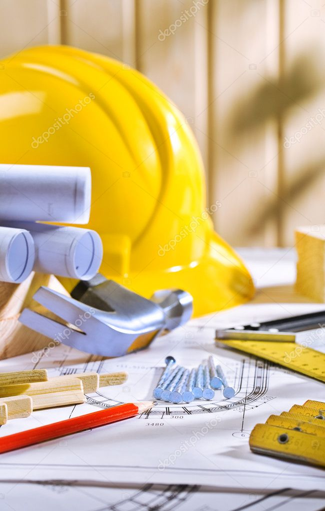 Carpentry tools on table with blueprints — Stock Photo #10925899