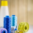 Composition of spools and thimbles with measure tape — Stock Photo