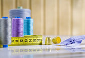 Composition of sewing items on white table — Stock Photo