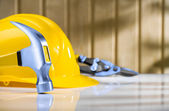 Claw hammer with hardhat and steel cutter — Stock Photo