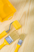 Brushes and roller with paint can — Stock Photo
