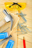 Composition of carpentry tools on wooden background — Stock Photo