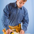 Carpenter does measurement — Stock Photo