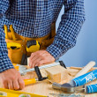 Close up view on work of carpenter — Stock Photo #11681547