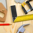 Set of carpentry tools on wooden planks — Stock Photo #11682185