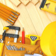 Photo: Set of construction tools on wooden boards