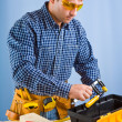 Worker takes carpenter vise - Stock Photo