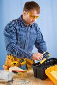 Worker takes carpenter vise — Stock Photo