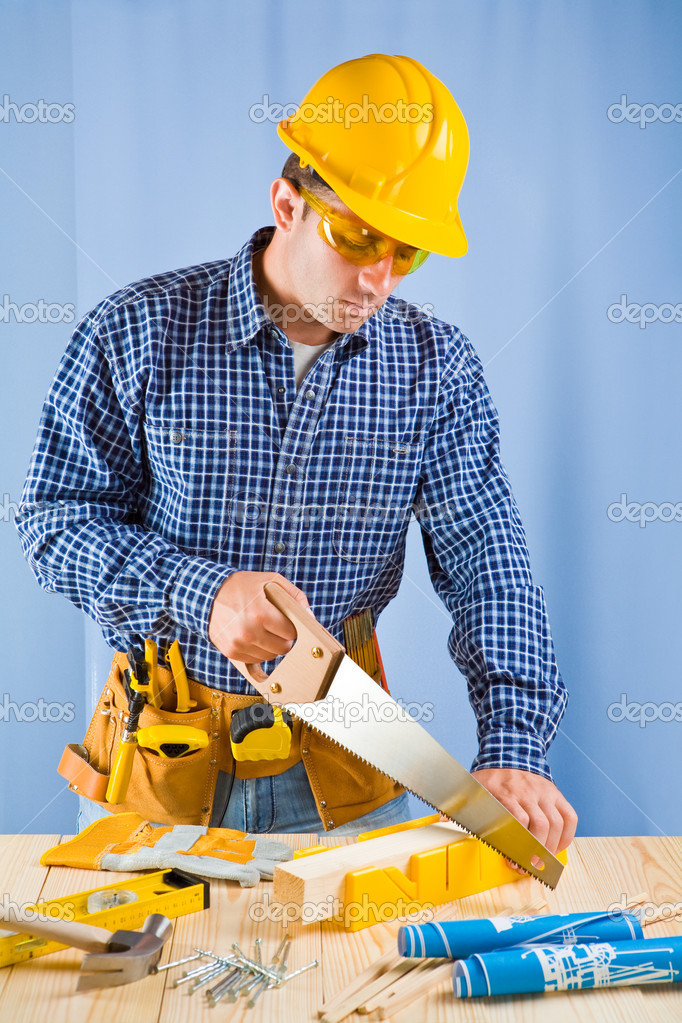 Carpenter works with handsaw  Stock Photo #11681403