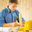 Stock Photo: Carpenter does sketching