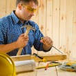 Stock Photo: Carpenter wih chisel