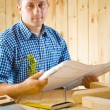 Carpenter with blueprint — Stock Photo