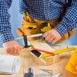 Close up up view on the work of carpenter — Stock Photo #11806160