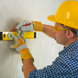 Worker with construction level and pencil — Stock Photo #11806985