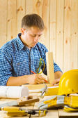 Carpenter does the sketching — Stock Photo