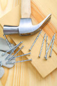 Composition of hammer and nails with glove closeup — Stock Photo