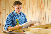 Worker with blueprint — Stock Photo