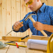 Stock Photo: Carpenter works with chisel