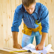 Men looks on the blueprint — Stockfoto
