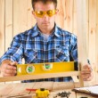 Stock Photo: Men works with level
