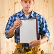 Worker with clipboard - Stock Photo