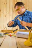 Carpenter works with the chisel — Stock Photo