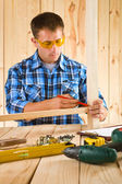 Worker sketh on the plank — Stock Photo