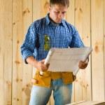 Carpenter with blueprint — Stock Photo #12195816