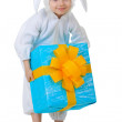 Child dressed as a rabbit with a gift box — Stock Photo