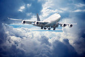 Aircraft is going for landing. Against cloudy sky — Stock Photo