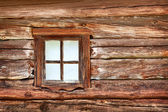 Small window in the old wooden wall — Stock Photo