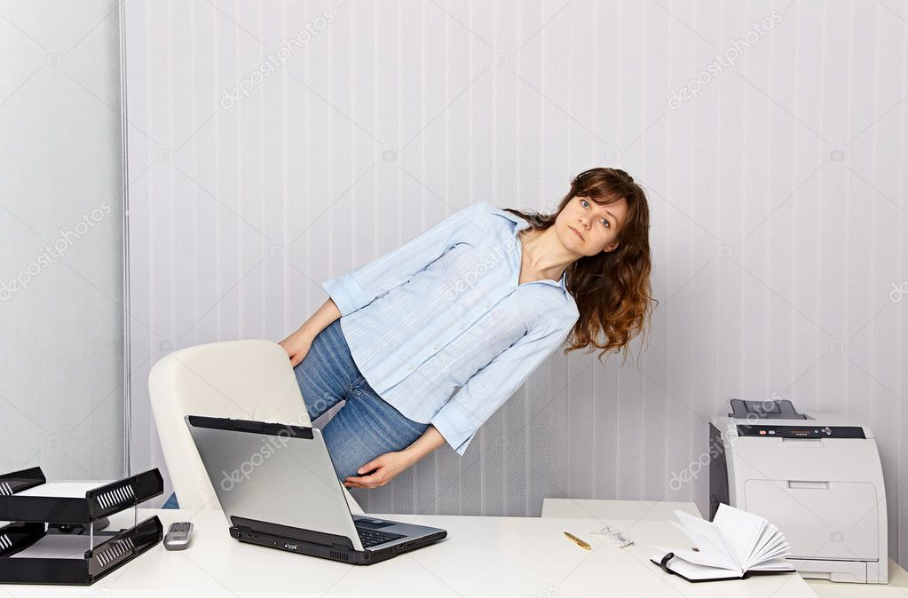 The girl - office worker goes crazy with work  Stock Photo #10944119
