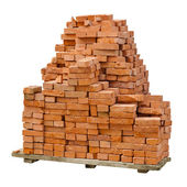 Stack of red clay bricks on white background — Stock Photo