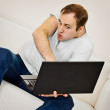 Comic man plays on a laptop — Stock Photo #11026788