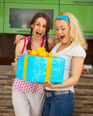 Happy friends with a large gift in the hands — Stock Photo