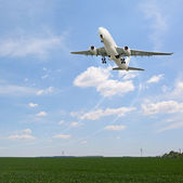 Passenger aircraft taking off — Stock Photo
