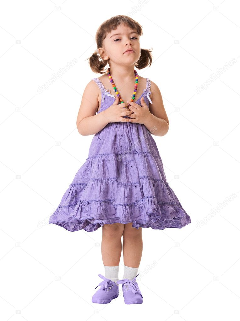 A little dissatisfied girl in a lilac dress on a white background — Stock Photo #11284389
