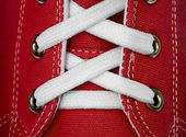 White lace on red sneakers — Stock Photo
