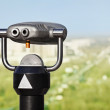 Binoculars to observe green city — Stock Photo