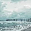 Old jetty over the stormy sea — Stock Photo