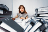 Business woman working in office with documents — Stock Photo
