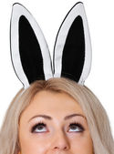 Girl's face with the rabbit ears on white — Stockfoto